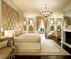 Opulent padded headboard wall, all the way up to the ceiling.