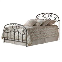 Bring country-chic style home with this timeless metal bed, featuring scrolling details and a rusty gold finish.   Product: Bed...