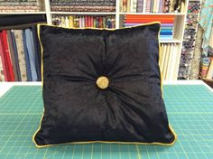 This beautiful and stunning crushed velvet cushion and pad piped in a gold shimmering trim approximately 16 x 16 Colour Black with gold piping trim