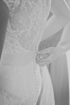 Mother of the Bride assisting with lace back wedding gown // Madison Rose Photography