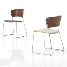 Arc 1.2, stackable side chairs on sled base with wooden back and upholstered seat.