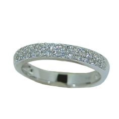 Classic diamond wedding band with 1/2 carat of round brilliant cut diamonds pave'd across the top in 14 karat white gold.