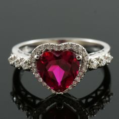 Fashion & style in one, this gemstone ring is made with a heart cut red ruby.  A beautiful design and a testament to cutting edge jewellery styles.  See stylish jewellery differently with this glamorous gemstone ring design that appeals to those who count most. Stylish Jewelry, Fashion Jewelry, Ring Designs, Sparkles, Wedding Stuff, Heart Ring, Count, Gemstone Rings, Glamour
