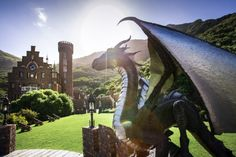 Perched upon the Karbonkelberg Mountain in Hout Bay, the Litchtenstein Castle is something out of a fairytale – with a guarding dragon statue, a tower and a ballroom fit for royalty. Lichtenstein Castle, Gothic, Bed Frame Design, Villa, Honeymoon Suite, Elegant Chandeliers, Black And White Theme, Dragon Statue, Event Venues