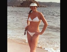 1978  Joan Collins shared this bikini throwback picture