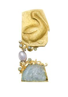"""Linda Kindler Priest: Baby Pelican, 2 part brooch in 14k yellow gold, 80pt green sapphires, 61pt sapphires, and aquamarine crystal. Approx 3 x 1 1/4"""""""