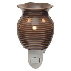 Groovy Brown Plug-in Scentsy Warmer    Groovy Brown features a flirty shape and deep ridges in a natural shade of brown.