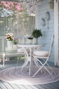 Shabby Chic french style vintage outdoor decor, this bistro set is so pretty and love the chandelier above! Need this for my summer house! www.melodymaison.co.uk