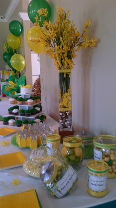 Green & Yellow Baby shower featuring a  Cupcake tower & Candy Bar