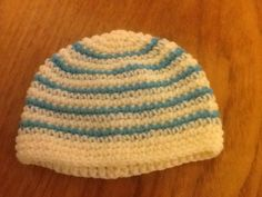 Cream and turquoise hat
