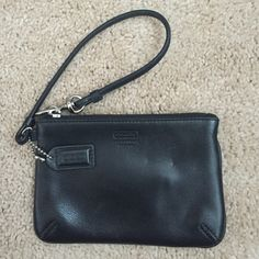 Coach wristlet Black coach wristlet. Excellent condition. Measures 4 inches high by 6 inches wide. No trades. Coach Bags Clutches & Wristlets
