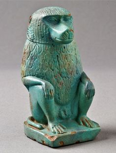 Important Egyptian Faience Baboon. Early Late Period, Dynasty XXVI, circa 664-525 BC. This and more important ancient art for sale on CuratorsEye.com