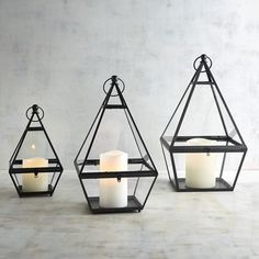 Think outside the box. Our triangle lanterns, handcrafted of glass and a hand-painted, rust-resistant iron frame, are the perfect way to light up a patio, tabletop or shelf with a bit of modern design.