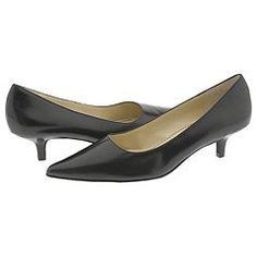 Don't like heels?....Some heel is better than none.  Try a kitten heel for the interview.