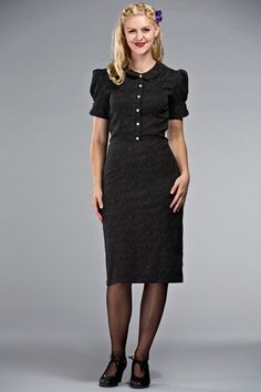 The delightful daytime dress. Black with white dots. From Emmy Design.