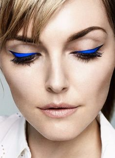 Simple complexion, but a beautiful electric blue eyeliner make this look entirely appropriate for day and night.