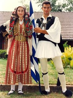 Europe | Portrait of a couple wearing traditional clothes, Greece..**