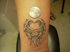 heart/wings tattoo.....maybe something like this in between my shoulders since my name is angel and to go with my love theme :) genius!