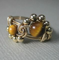 Wire Wrapped Binary Ring in Gold Filled and Tiger's Eye Wire Jewelry, Jewelry Crafts, Jewelry Rings, Wire Bracelets, Diy Rings, Wire Earrings, Earrings Handmade, Jewelry Art, Jewelry Ideas
