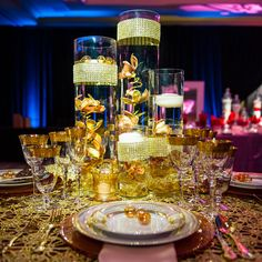 Orchid and Floating Candle Vase Centrepieces -- Love the look of the bling!