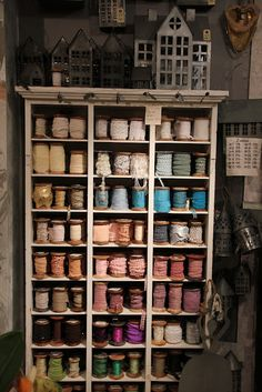 I love the vintage display but I really LuRvE all the colorful trim and ribbons. - craft room inspiration <3