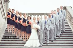I really like the way they inverted the usual 'wedding party picture' by placing the bride and groom in the front! Absolutely love it!