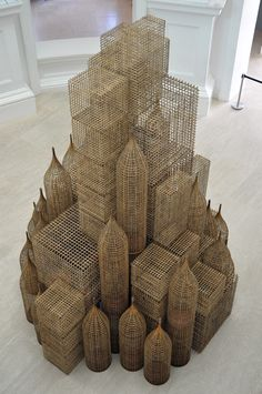 COMPOUND, by SOPHEAP PICH, 2011, BAMBOO, RATTAN, PLYWOOD, AND METAL WIRE INSTALLATION FOR THE 2011 SINGAPORE BIENNALE  117 X 134 X 126 IN. (450 X 340 X 320 CM)