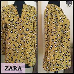 ZARA Chetah Blouse 100% Polyester ZARA Blouse with a gorgeous cheetah print, 3/4 sleeves with gold snap buttons. Beautiful V- Neckline with 2 snap gold buttons. The back of the shirt as you can see in picture 2 gathers at the bottom so flatteringSize Small Brand New Zara Tops Blouses