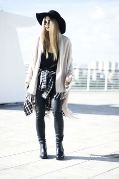 Shop this look on Lookastic:  https://lookastic.com/women/looks/dress-shirt-tank-jeans-chelsea-boots-hat-scarf-sunglasses/5415  — Black and White Check Dress Shirt  — Black Leather Jeans  — Black Leather Chelsea Boots  — Black Sunglasses  — Black Wool Hat  — Beige Scarf  — Black Tank