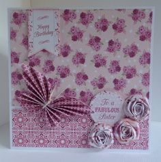 Card designed by Julie Hickey using Bonbon 6x6 paper pad, die cuts and template. Gorgeous card, very pretty pink with folded butterfly and spiral roses.