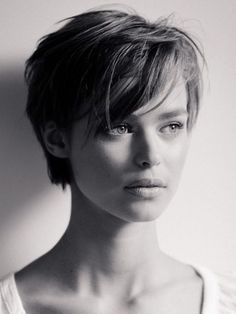 Side sweeping bangs and a blunt cut in the back of this pixie cut.