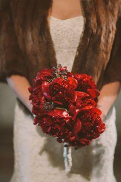 red bridal bouquet, photo by Amber Gress http://ruffledblog.com/long-island-city-wedding #weddingbouquet #flowers