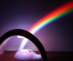 For the people who hope for unrealistic things dreamers among us, this cool little light machine sits on just about any flat surface and sends a rainbow flying across your room.