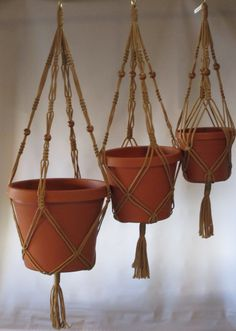 Macrame Plant Hangers Vintage Style TRIO 24 inch, 30 inch, and 36inch BEADS Sand. $25.99, via Etsy.
