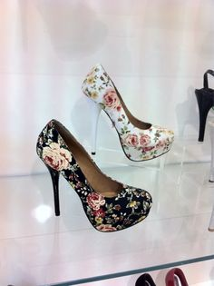 I don't care what you people say!  They are sexy and pretty and cure and I want them on my feet!    Flower pattern heels