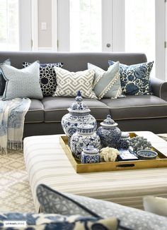 Style your coffee table with a clustered grouping of blue and white ginger jars and accessories. Use the same idea for any monochromatic display.