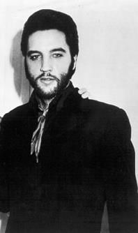 Elvis Presley - too weird! Just so different! Once the movie was over...the facial hair was too. :o)