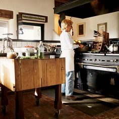oh, I have a dream...of owning a butcher-block island like this. This whole kitchen is pretty amazing, actually. The salvaged 10-burner stove? Yes, please!