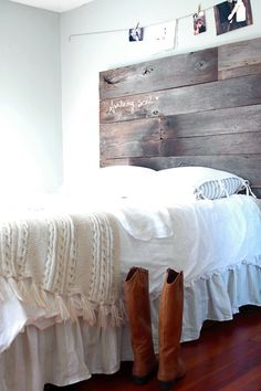 love the wood and the white linens and walls
