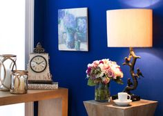 I adore that shade of blue. It makes all of the furniture pieces look ceisp and clean.