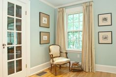 Living Room created by Laurie Gorelick Interiors with antiques from French Antiques Direct, Natick, MA. Lee Jofa fabric on chair. Drapery fabric by Kravet. Photo Marie Picard Craig Photography