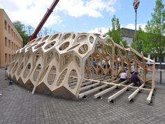 A cocoon-like temporary summer pavilion in Saarbrücken, Germany, is the result of a research project on biomimicry conducted at the city's architecture school. Wood Projects That Sell, Wood Pallet Art, Wood Architecture, Pavilion Architecture, Digital Fabrication, Prefabricated Houses, Parametric Design, House With Porch, Interiors