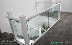 Square newels in white with clamped glass