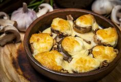 Baked mushrooms with cheese Suluguni