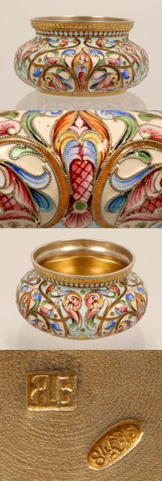A Russian silver gilt and shaded cloisonne enamel salt, Yakov Borisov, Moscow, circa 1896-1908. The bombe sided circular salt completely worked in a multi-color scrolling floral and foliate motif against a cream and pale blue ground and banded by a row of white enamel beads.