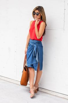 A red tank and asymmetrical denim skirt.  See more on The Darling Detail.   via @AOL_Lifestyle Read more: http://www.aol.com/article/2016/06/29/july-4th-style-what-to-wear/21421489/?a_dgi=aolshare_pinterest#fullscreen
