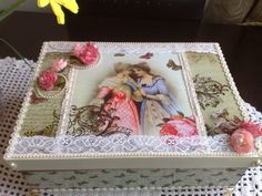 Like the combination of vintage ladies image, flowers, ribbons, lace and fabric/papers to make this pretty box - Sweet idea for gift/treasure/sewing box! :)