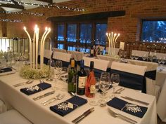 Winter wedding theme - close ups of candle centrepieces and place settings