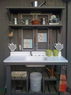 My Mother's Day Potting Bench is now ready to be used! My husband built it for me with a vintage sink and shabby chic door from Habitat for Humanity. He's the best!