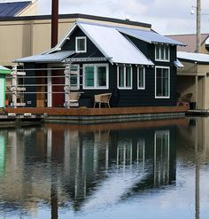 This floating guest house is nestled among a community of eclectic houseboats on the Willamette River in Portland, Oregon. The project was designed to work as a part-time residence for a couple's use while their main floating home is being built. After moving into the main house, the guest house will become a vacation retreat for visiting family and friends.